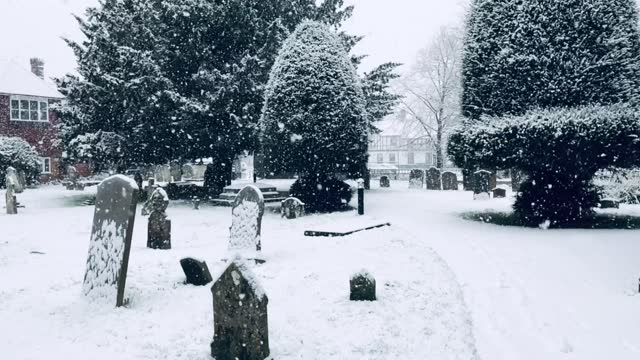 Snow Falls On The Churchyard In Beaconsfield Old Town