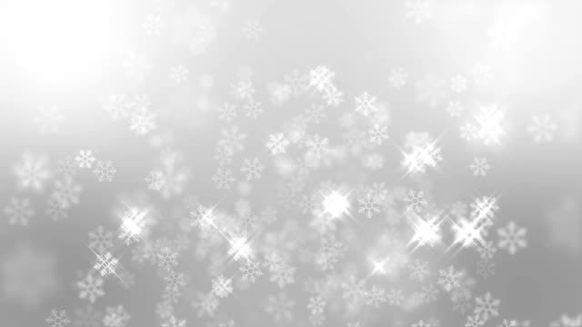 snow flakes falling with sparking light on blue background, christmas background - snowflake background stock videos & royalty-free footage