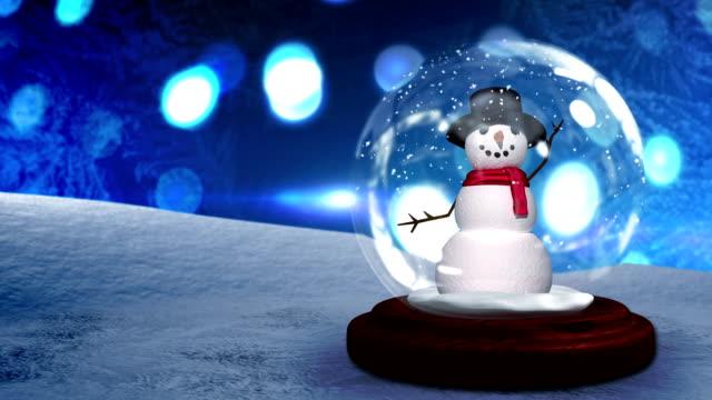 vídeos y material grabado en eventos de stock de saludar con la mano de hombre de nieve en la nieve mundo - snowman
