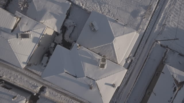 Snow over roofs raw video