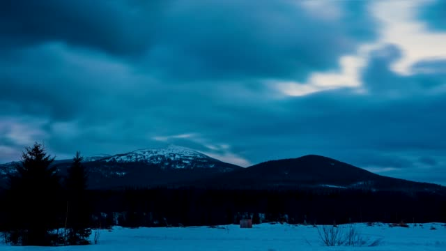 Snow peaks Mountains nature Background landscape Timelapse. Video. Clouds moving in Blu sky Panorama. Winter mountain at sunset over clouds in a valley. Sundown winter mountain, timelapse video