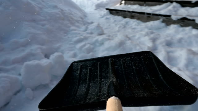 Snow removal with a shovel. video