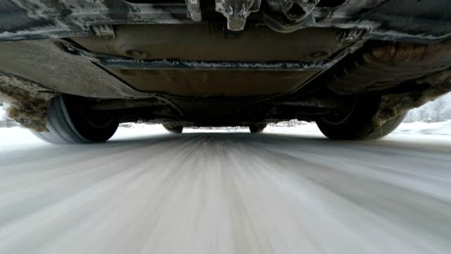 Snow road driving, camera below car video