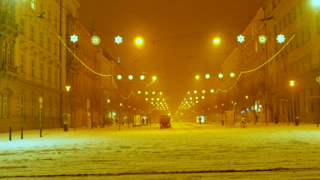 Snow storm at Night In the city center. Central Europe. video