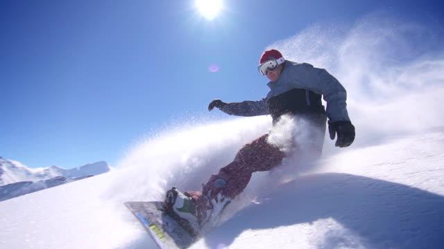 Snowboarder does powder turn video