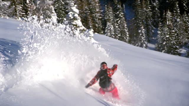 Snowboarder doing powder turn video