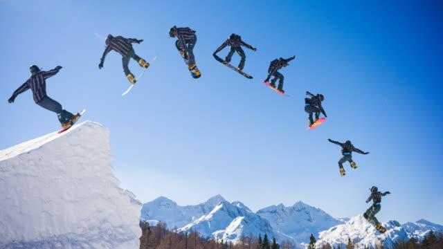 vídeos de stock e filmes b-roll de snowboarder jump montage - continuidade