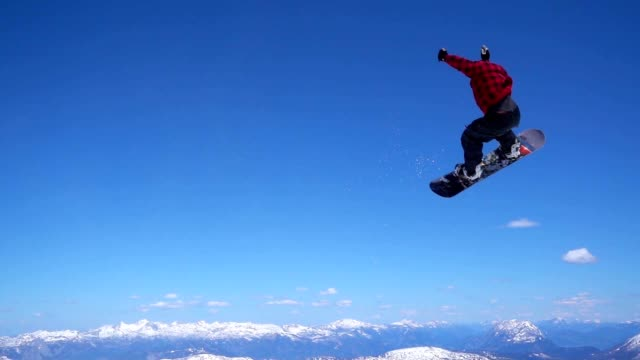 SLO MO Snowboarder making a 360 jump video
