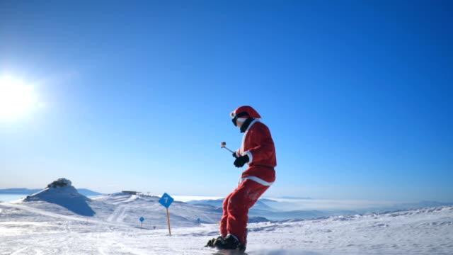 スノーボーダーのスキースロープ - スポーツウェア点の映像素材/bロール