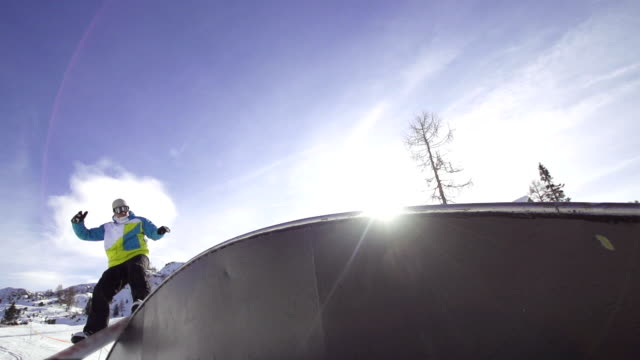 SLOW MOTION: Snowboarder rides a rainbow box SLOW MOTION: Snowboarder rides a rainbow box railing stock videos & royalty-free footage