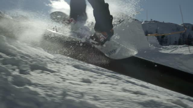 SLOW MOTION: Snowboarder riding kink rail video