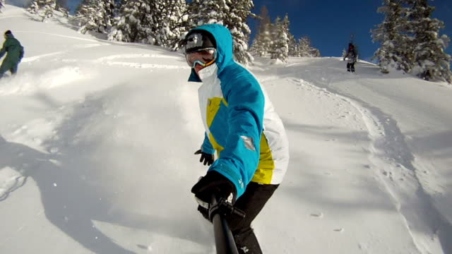 Snowboarder riding powder video