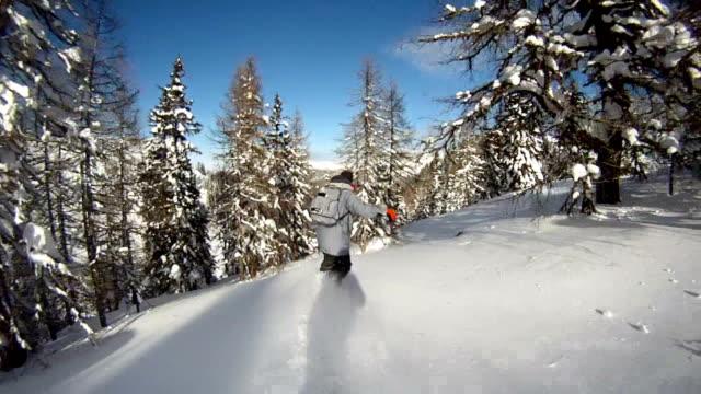 Snowboarder riding powder