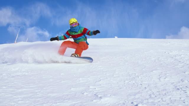 SLO MO Snowboarder spraying snow at camera video