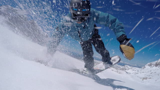 Snowboarder taking a selfie while spraying snow video