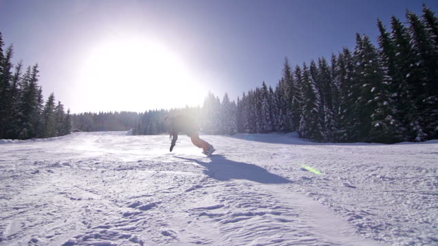 Snowboarder turns on slope video