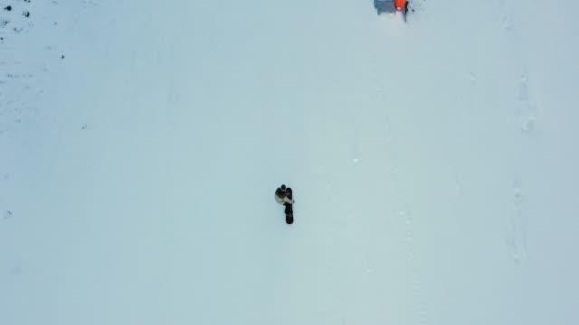 snowboarding drone aerial straight above view snowboarder shredding down snowy mountain ski slope - sci sci e snowboard video stock e b–roll