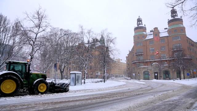 stockvideo's en b-roll-footage met snowcat, snow bulldozer, clear snowfall from road stockholm sweden - shovel