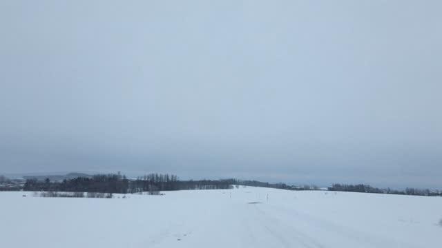 Snow-covered road (Biei,Hokkaido) Snow-covered road (Biei,Hokkaido) natural condition stock videos & royalty-free footage