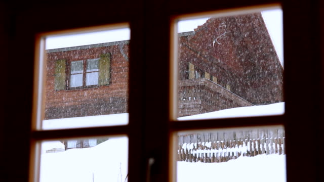 Snowfall behind window Snowfall behind window, with close up. bay window stock videos & royalty-free footage