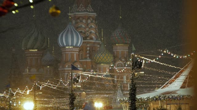snowfall in the background of Saint Basil's Cathedral.