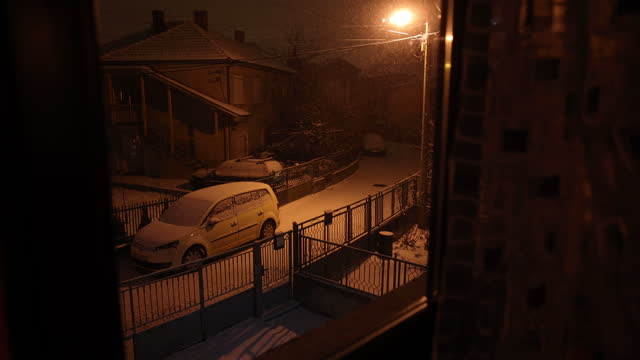 Snowfall scene during the night in the city video