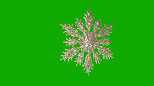 stockvideo's en b-roll-footage met snowflake on a green background - kerstbal