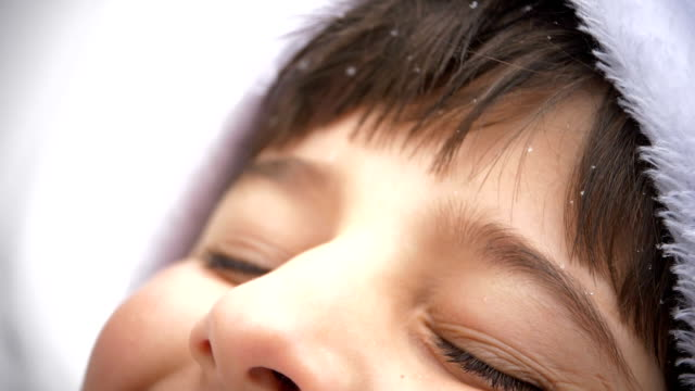 snowflakes fall on the child's face video