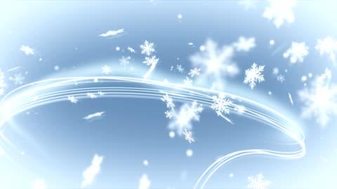 vidéos et rushes de flocons de neige avec des lignes lumineuses. mise au point sélective. - hiver