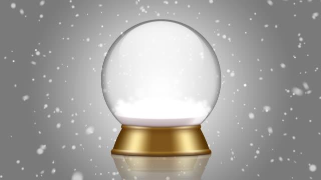 snowglobe animering på en grå bakgrund - snöflinga bildbanksvideor och videomaterial från bakom kulisserna