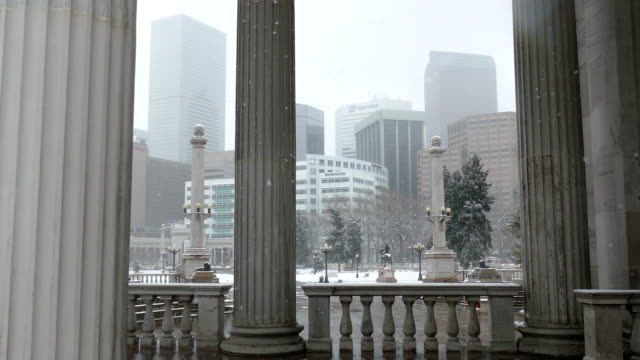 Snowing Civic Center Park Greek Theater Downtown Denver skyline Colorado winter video