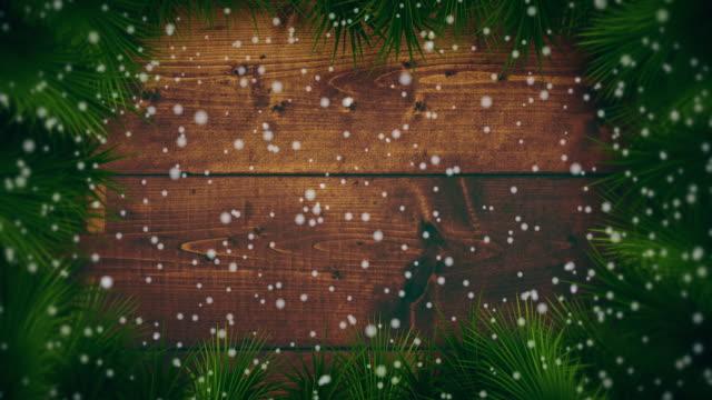 vídeos de stock e filmes b-roll de snowing on christmas backgrounds - christmas card