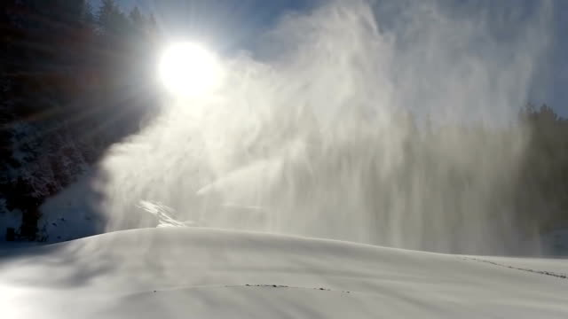 Snowmaking is the production of snow on ski slopes, SLOW MOTION video