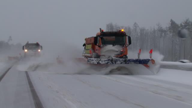 snowplow on german autobahn - salt video stock e b–roll