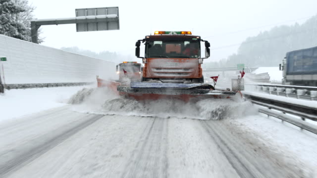 Snowplows Removing Snow From The Highway video
