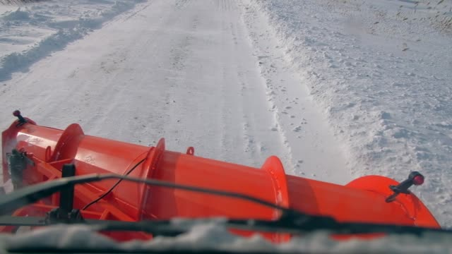 Snow-removing machine removes snow from the road. View in cabin driver Snow-removing machine removes snow from the road. View in cabin driver. Slow motion. plow stock videos & royalty-free footage