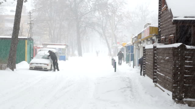 Snowstorm and snow covered streets of the town. video