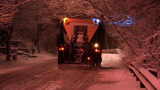 Snowstorm salt truck. video