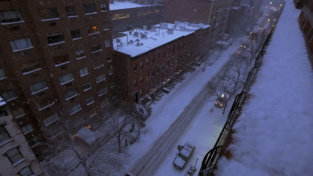 Snowy City in Wintertime. Large Metropolis Covered in Snow. video