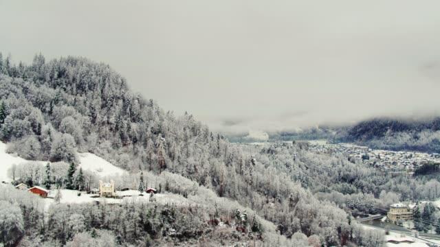 Snowy Forest on Mountain Slopes in Interlaken, Switzerland - Drone Shot video