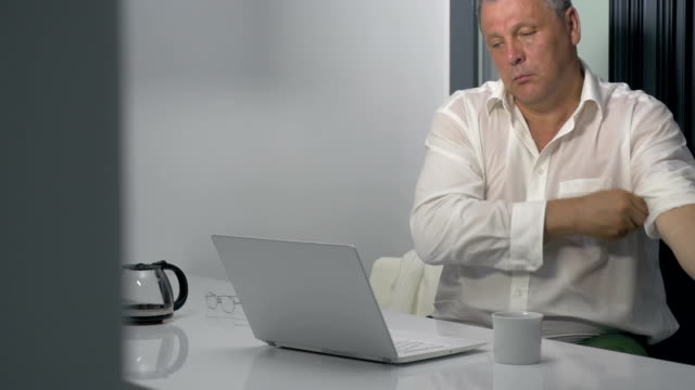 So many work to do Senior businessman pulling up the sleeves of shirt, putting on glasses and having coffee. He is ready to start long and hard work sleeve stock videos & royalty-free footage