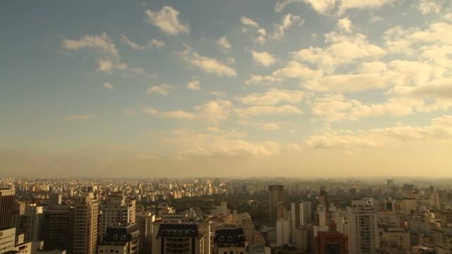 São Paulo city skyline A sunny skyline of the city of São Paulo with hundreds of sky scrapers, Ibirapuera park, and clouds slowly passing. são paulo state stock videos & royalty-free footage