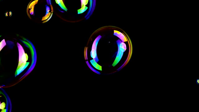 Soap bubble background Colorful soap bubbles fly across black background. giant fictional character stock videos & royalty-free footage