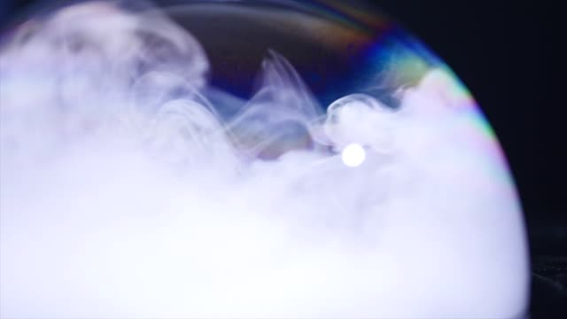 soap bubbles with smoke on black background video