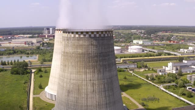 Soaring heat power station, aerial flight nearby. In the summer, shot 4k. Close up.