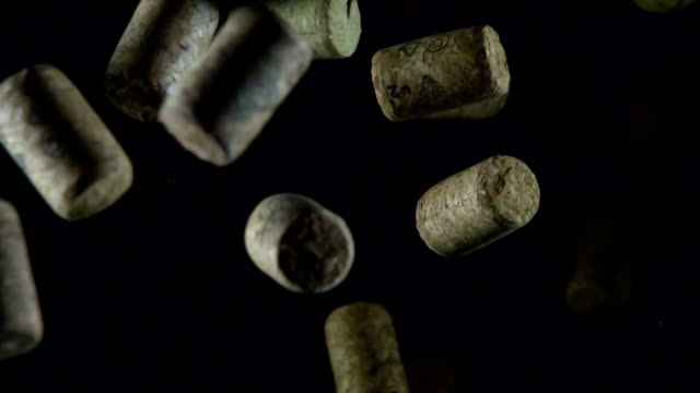 Soaring Wine Corks Wine corks in large quantity in the air slowly stuck on a black background. Filmed at a speed of 240fps cork stopper stock videos & royalty-free footage