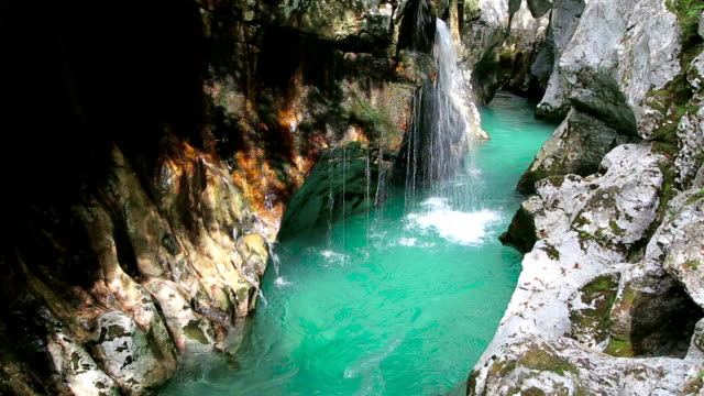 Soca river Great Gorges waterfalls Soca river Great Gorges water falls with turquoise waters is 750 m long, 2 to 10 m wide and up to 15 m deep. Trenta, Slovenia. purified water stock videos & royalty-free footage