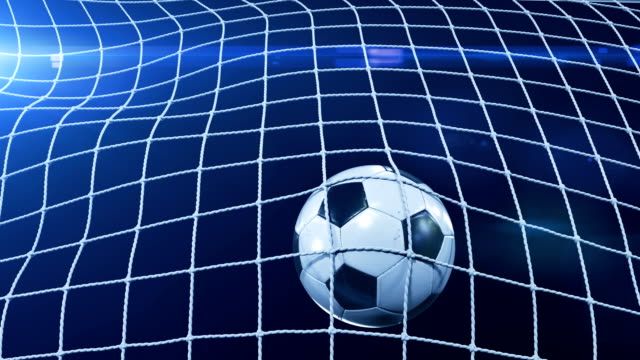 vídeos de stock e filmes b-roll de soccer ball flying in goal net in slow motion. black background and flares. sport concept. beautiful football 3d animation of the goal moment. - campeão soccer football azul