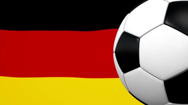 fußball-kugel-schleife mit deutscher flagge hintergrund - sportliga stock-videos und b-roll-filmmaterial