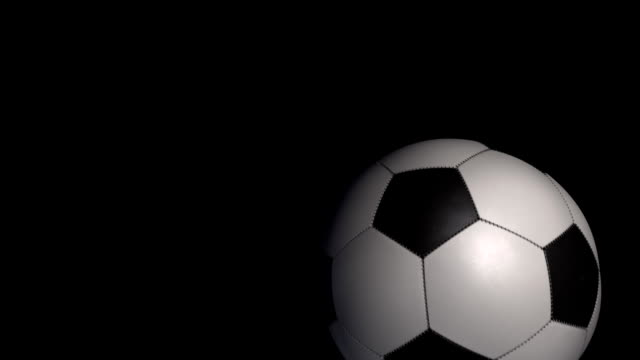 Soccer Ball transition on a black background with alpha. video